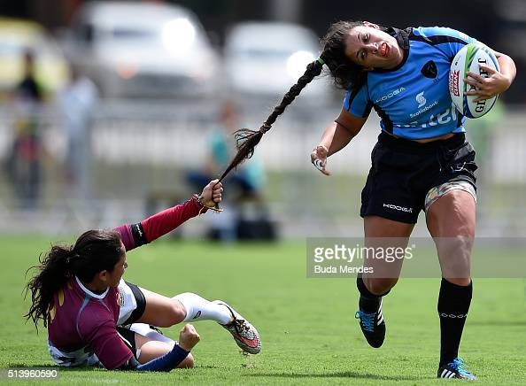 Maryoly Gamez of Venezuela battles for the ball against Victoria Rios of Uruguay during the International Womens Rugby Sevens Aquece Rio Test Event...