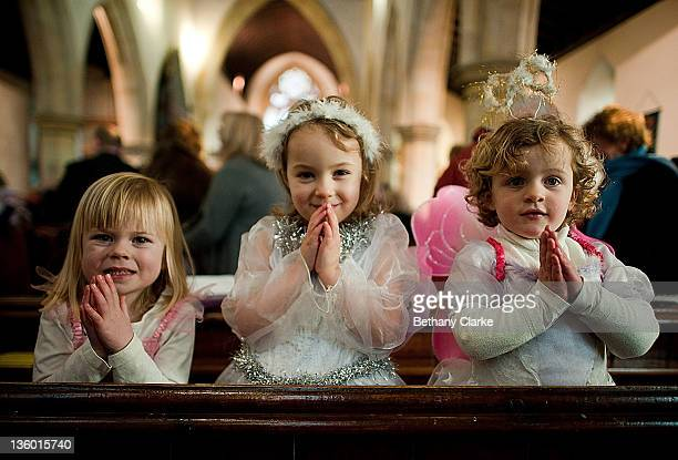 MarySarah Dean Emily Walsh and Emily Frew angels wait for their cue during a traditional Christmas Nativity on December 18 at St Mary's Church Myton...