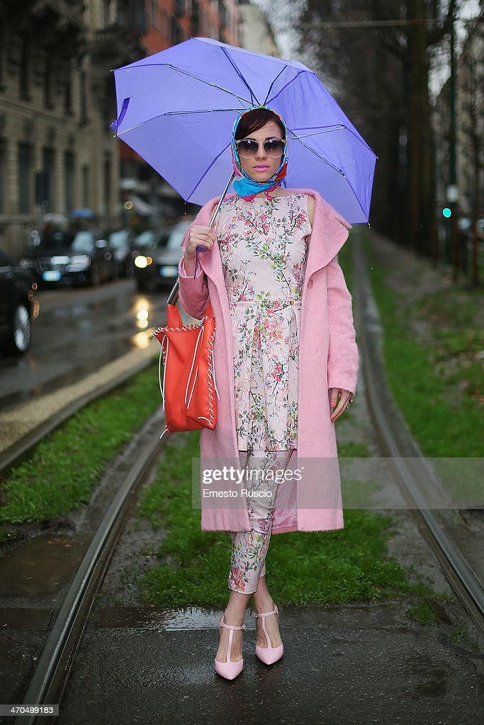 Marzia Peragine wears Melacerba dress, Asus coat and F2A bag on day 1 of Milan Fashion Week Womenswear Autumn/Winter 2014 on February 19, 2014 in Milan, Italy.