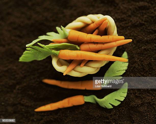 Marzipan carrots in basket