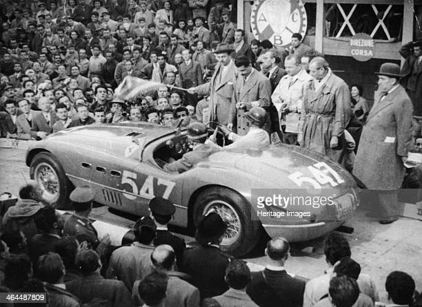 G Marzotto in a 41 Ferrari taking part in the Mille Miglia 1953 They are at the start of the race with an official by the side of them starting the...