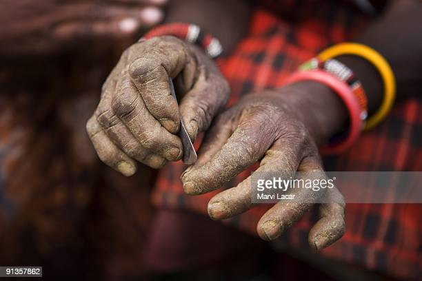 Masaai villager displays the traditional blade used to circumcise young girls August 12 2007 in Kameli Kenya Maasai are a pastoral group mostly...