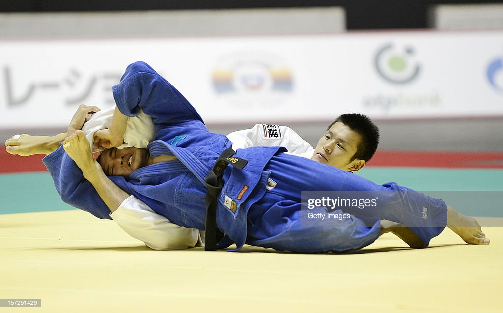 Masaaki Fukuoka of Japan (R) and Meirzhan Kaltayev of Kazakhstan compete in the Men's 60kg first round match during day one of the Judo Grand Slamat Yoyogi Gymnasium on November 30, 2012 in Tokyo, Japan.