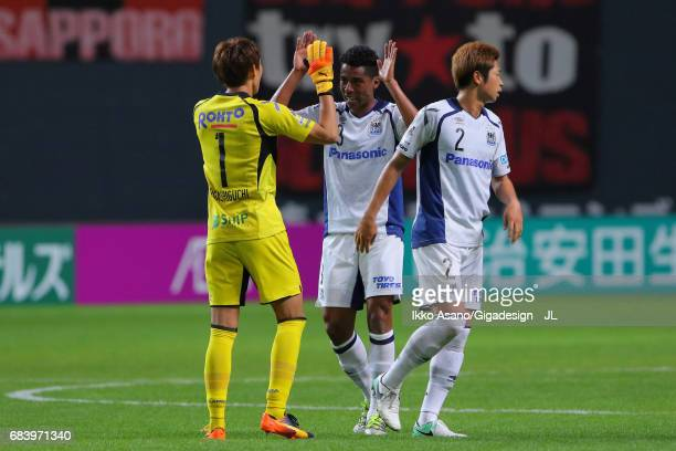Masaaki Higashiguchi Fabio and Genta Miura of Gamba Osaka celebrate their 20 vicgtory in the JLeague J1 match between Consadole Sapporo and Gamba...