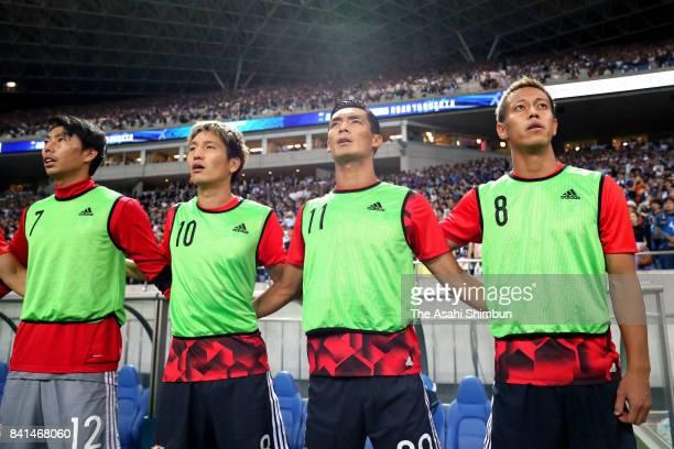 Masaaki Higashiguchi Genki Haraguchi Tomoaki Makino and Keisuke Honda of Japan line up for the national anthem prior to the FIFA World Cup Qualifier...