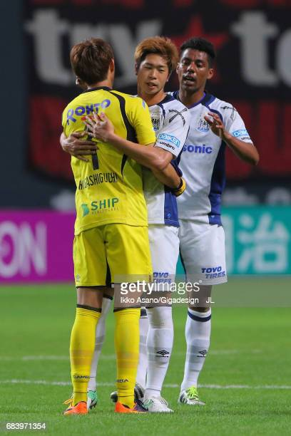 Masaaki Higashiguchi Genta Miura and Fabio of Gamba Osaka celebrate their 20 vicgtory in the JLeague J1 match between Consadole Sapporo and Gamba...