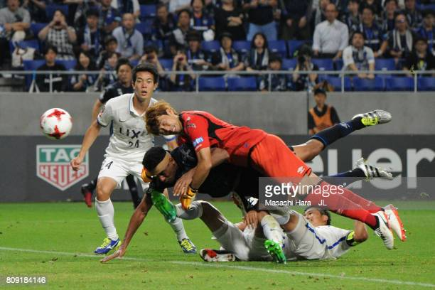 Masaaki Higashiguchi of Gamba Osaka dives for the header at the last minutes of the game during the JLeague J1 match between Gamba Osaka and Kashima...