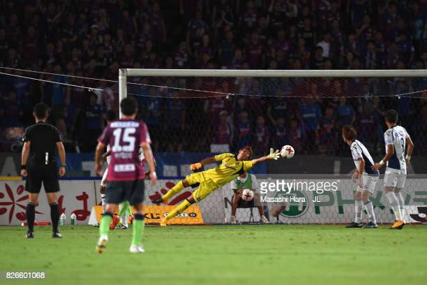 Masaaki Higashiguchi of Gamba Osaka dives in vain as Wilson of Ventforet Kofu scores the opening goal during the JLeague J1 match between Ventforet...
