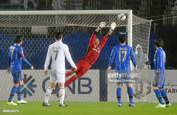 Masaaki Higashiguchi of Gamba Osaka dives in vein to allow a goal during the AFC Champions League Group F match between Gamba Osaka and Buriram...
