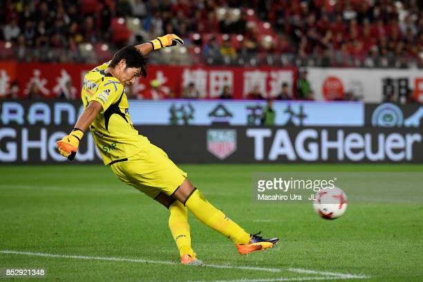 Masaaki Higashiguchi of Gamba Osaka in action during the JLeague J1 match between Kashima Antlers and Gamba Osaka at Kashima Soccer Stadium on...
