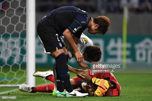 Masaaki Higashiguchi of Gamba Osaka lies injured during the JLeague J1 match between Gamba Osaka and Kashima Antlers at Suita City Football Stadium...