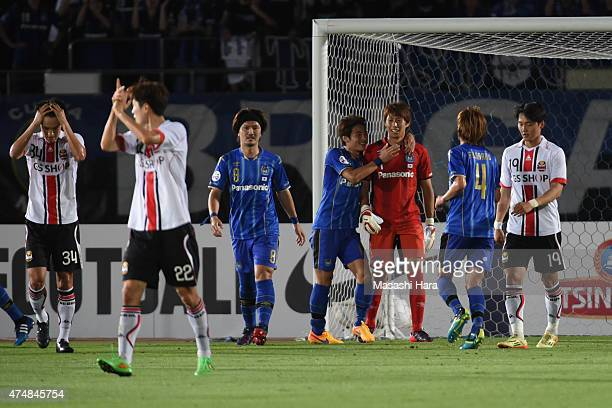 Masaaki Higashiguchi of Gamba Osaka looks on after FC Seoul missed PK during the AFC Champions League Round of 16 match between Gamba Osaka and FC...