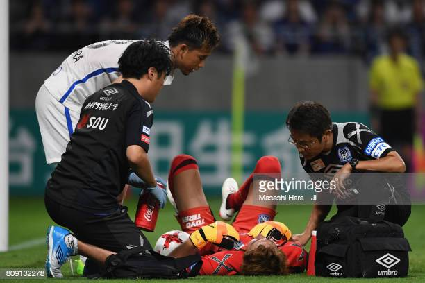 Masaaki Higashiguchi of Gamba Osaka receives medical treatment during the JLeague J1 match between Gamba Osaka and Kashima Antlers at Suita City...