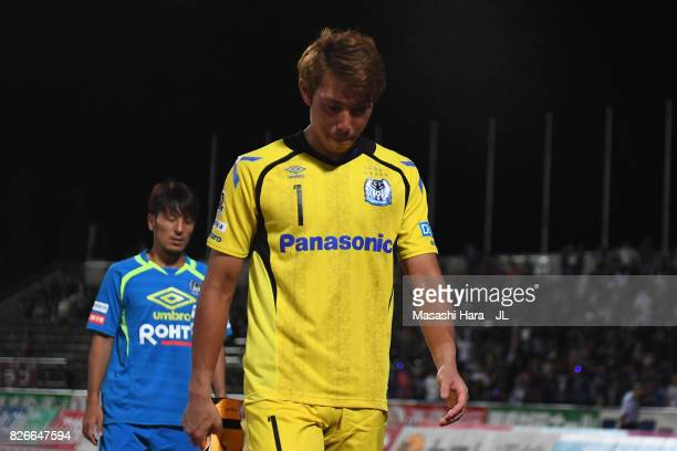 Masaaki Higashiguchi of Gamba Osaka shows dejection after his side's 01 defeat in the JLeague J1 match between Ventforet Kofu and Gamba Osaka at...