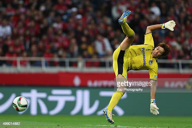 Masaaki Higashiguchi of Gamba Osaka tries to clear the ball during the JLeague 2015 Championship semi final match between Urawa Red Diamonds and...