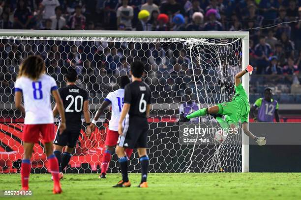 Masaaki Higashiguchi of Japan dives in vain as Duckens Nazon of Haiti scores his side's third goal during the international friendly match between...