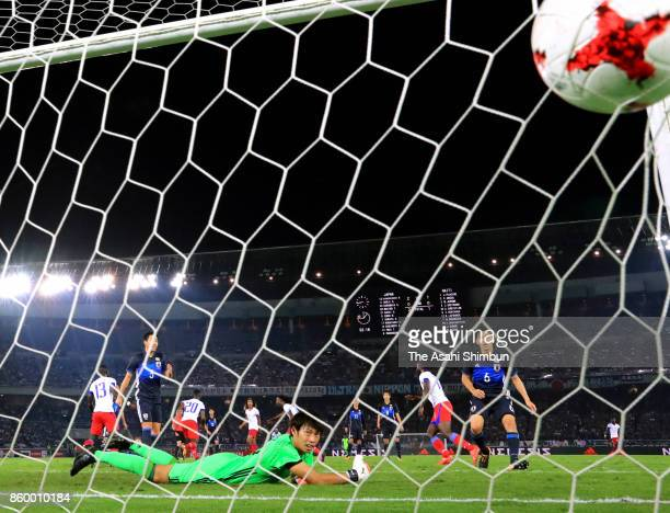 Masaaki Higashiguchi of Japan dives in vain as Duckens Nazon of Haiti scores his side's second goal during the international friendly match between...