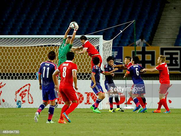 Masaaki Higashiguchi of Japan makes a save against Chinese team during the EAFF East Asian Cup 2015 final round at the Wuhan Sports Center Stadium on...