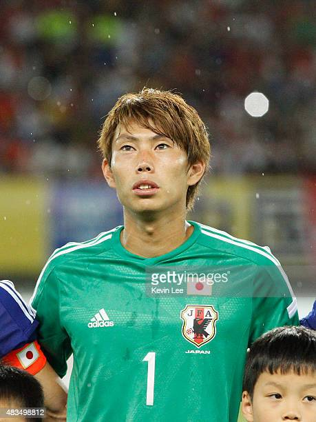 Masaaki Higashiguchi of Japan stands on the field before the match against China during the EAFF East Asian Cup 2015 final round at the Wuhan Sports...