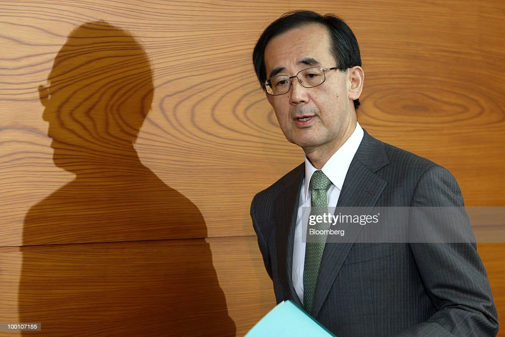 Masaaki Shirakawa, governor of the Bank of Japan, arrives for a news conference at the central bank's headquarters in Tokyo, Japan, on Friday, May 21, 2010. The Bank of Japan said it will provide one-year loans to banks to encourage lending and defeat deflation, and raised its assessment of the export-led recovery. Photographer: Kiyoshi Ota/Bloomberg via Getty Images
