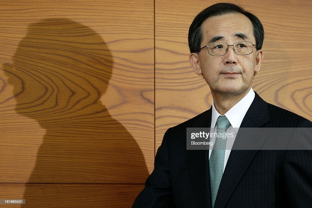 Masaaki Shirakawa, governor of the Bank of Japan, arrives for a news conference at the central bank's headquarters in Tokyo, Japan, on Thursday, Feb. 14, 2013. Asian stocks rose after the Bank of Japan maintained its asset-purchasing program before its governor steps down next month. Photographer: Kiyoshi Ota/Bloomberg via Getty Images