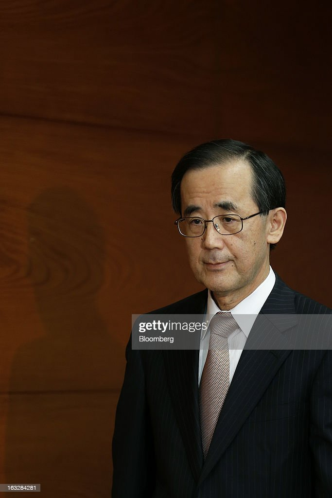 <a gi-track='captionPersonalityLinkClicked' href=/galleries/search?phrase=Masaaki+Shirakawa&family=editorial&specificpeople=5103203 ng-click='$event.stopPropagation()'>Masaaki Shirakawa</a>, governor of the Bank of Japan, arrives for a news conference at the central bank's headquarters in Tokyo, Japan, on Thursday, March 7, 2013. The Bank of Japan rejected a call for an immediate start to open-ended asset purchases in Governor <a gi-track='captionPersonalityLinkClicked' href=/galleries/search?phrase=Masaaki+Shirakawa&family=editorial&specificpeople=5103203 ng-click='$event.stopPropagation()'>Masaaki Shirakawa</a>'s final meeting before a new leadership takes over at the central bank. Photographer: Kiyoshi Ota/Bloomberg via Getty Images