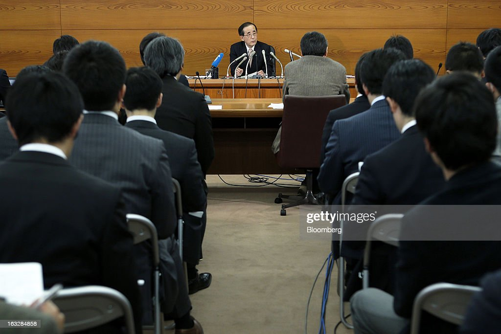 Masaaki Shirakawa, governor of the Bank of Japan, center, speaks during a news conference at the central bank's headquarters in Tokyo, Japan, on Thursday, March 7, 2013. The Bank of Japan rejected a call for an immediate start to open-ended asset purchases in Governor Masaaki Shirakawa's final meeting before a new leadership takes over at the central bank. Photographer: Kiyoshi Ota/Bloomberg via Getty Images