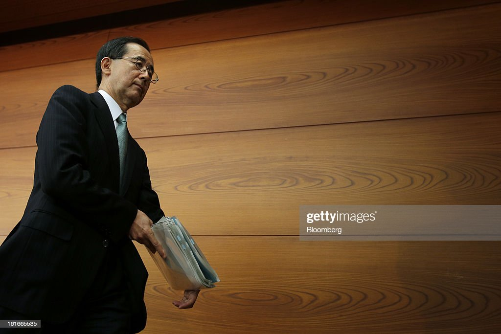 Masaaki Shirakawa, governor of the Bank of Japan, leaves a news conference at the central bank's headquarters in Tokyo, Japan, on Thursday, Feb. 14, 2013. Asian stocks rose after the Bank of Japan maintained its asset-purchasing program before its governor steps down next month. Photographer: Kiyoshi Ota/Bloomberg via Getty Images
