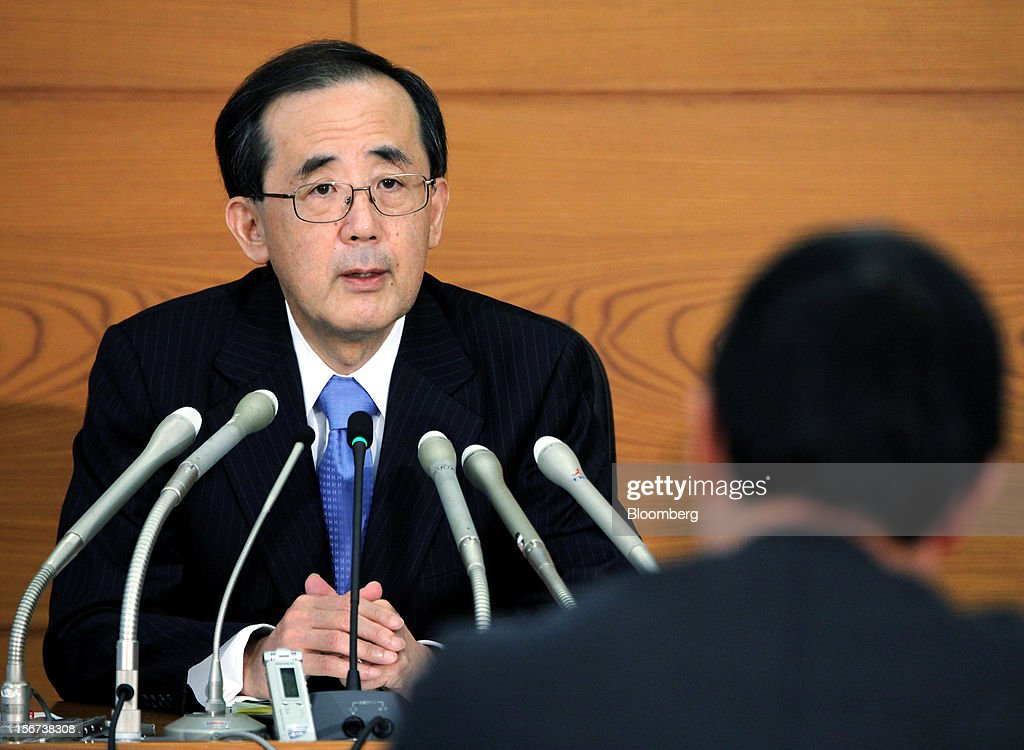 Masaaki Shirakawa, governor of the Bank of Japan, speaks during a news conference in Tokyo, Japan, on Tuesday, Nov. 20, 2012. Shirakawa pushed back against pressure on the central bank, criticizing the unlimited easing advocated by opposition leader Shinzo Abe and urging respect for the BOJ's independence. Photographer: Haruyoshi Yamaguchi/Bloomberg via Getty Images