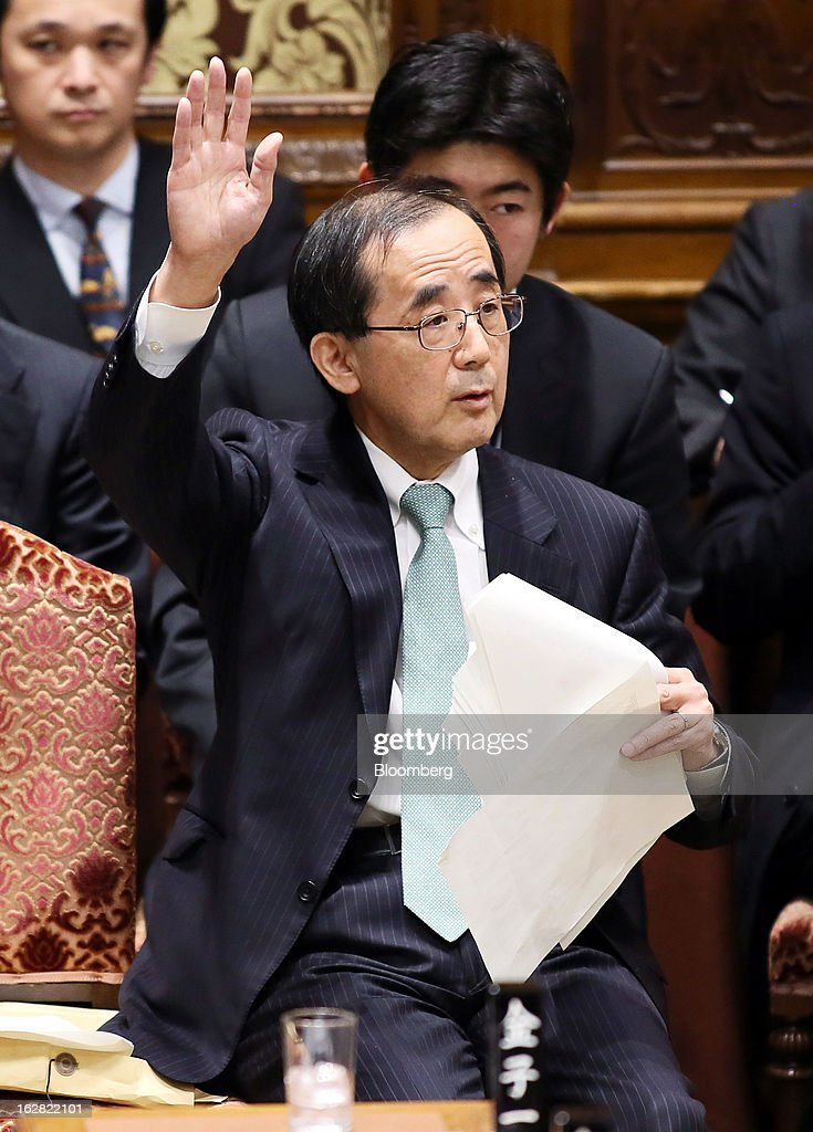 Masaaki Shirakawa, outgoing governor of the Bank of Japan, raises his hand during a lower house budget committee session at Parliament in Tokyo, Japan, on Thursday, Feb. 28, 2013. Japanese Prime Minister Shinzo Abe nominated Asian Development Bank President Haruhiko Kuroda to lead the nation's central bank, raising the likelihood of further monetary stimulus this year. Photographer: Haruyoshi Yamaguchi/Bloomberg via Getty Images
