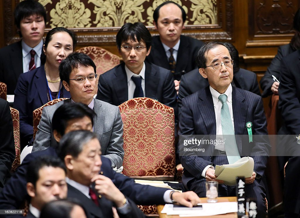 Masaaki Shirakawa, outgoing governor of the Bank of Japan, right, attends a lower house budget committee session at Parliament in Tokyo, Japan, on Thursday, Feb. 28, 2013. Japanese Prime Minister Shinzo Abe nominated Asian Development Bank President Haruhiko Kuroda to lead the nation's central bank, raising the likelihood of further monetary stimulus this year. Photographer: Haruyoshi Yamaguchi/Bloomberg via Getty Images