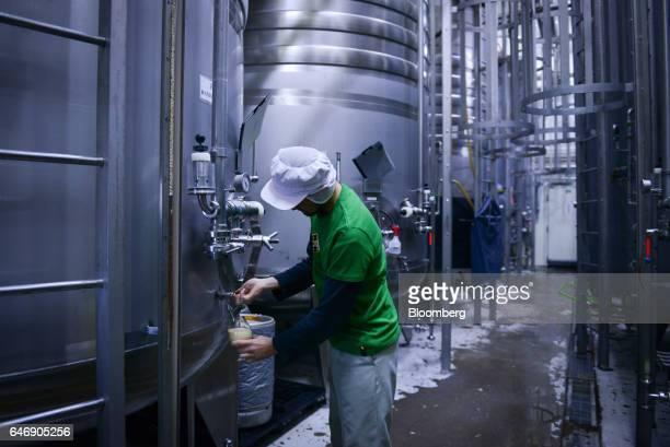 Masafumi Morita brewing director at YoHo Brewing Co fills a glass with beer from a fermentation tank at the company's brewery in Saku Nagano...