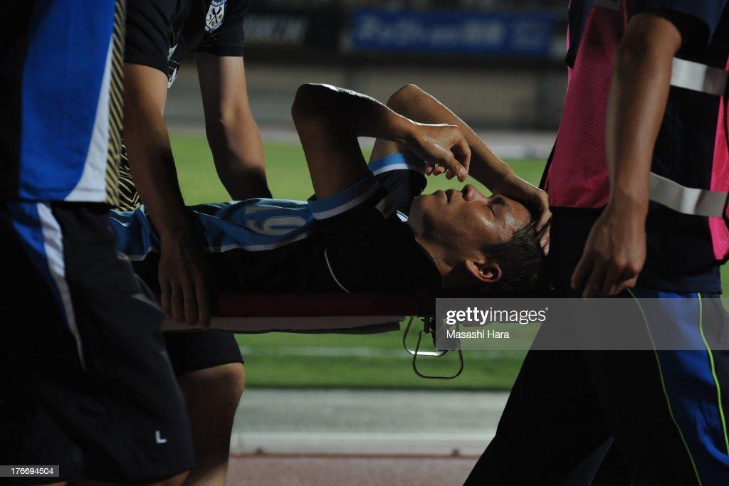 Masahiko Inoha #19 of Jubilo Iwata suffers an injury during the J.League match between Shonan Bellmare and Jubilo Iwata at BMW Stadium Hiratsuka on August 17, 2013 in Hiratsuka, Kanagawa, Japan.