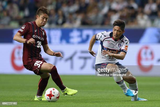 Masahiko Inoha of Vissel Kobe and Yoshito Okubo of FC Tokyo compete for the ball during the JLeague J1 match between Vissel Kobe and FC Tokyo at...