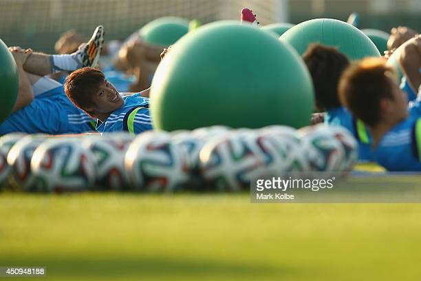 Masahiko Inoha stretches during a Japan training session at the Japan national team base camp at the Spa Sport Resort on June 20 2014 in Itu Sao Paulo