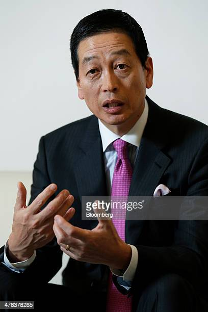 Masahiko Uotani incoming president and chief executive officer of Shiseido Co gestures as he speaks during an interview at the company's headquarters...