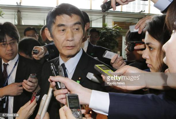 Masahiro Imamura answers reporters' questions at the prime minister's office in Tokyo after submitting a letter of resignation from the post of...