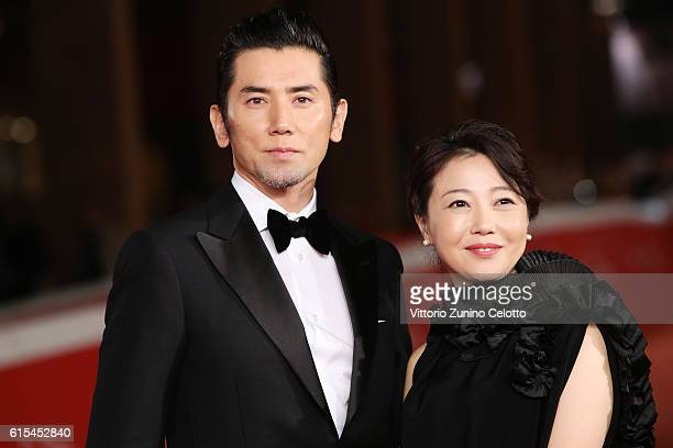 Masahiro Motoki and Miwa Nishikawa walk a red carpet for 'Nagai Iiwake The Long Excuse' during the 11th Rome Film Festival at Auditorium Parco Della...