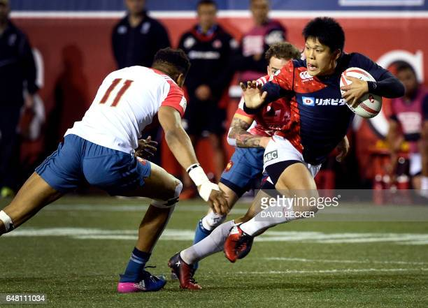 Masahiro Nakano of Japan looks to avoid Kelegh Moutome of France during their rugby match on day two of the USA Sevens Rugby tournament part of the...