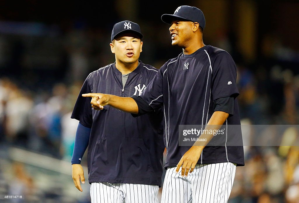 <a gi-track='captionPersonalityLinkClicked' href=/galleries/search?phrase=Masahiro+Tanaka&family=editorial&specificpeople=5492836 ng-click='$event.stopPropagation()'>Masahiro Tanaka</a> #19 and <a gi-track='captionPersonalityLinkClicked' href=/galleries/search?phrase=Ivan+Nova&family=editorial&specificpeople=5743486 ng-click='$event.stopPropagation()'>Ivan Nova</a> #47 of the New York Yankees have a laugh after a victory against the Baltimore Orioles at Yankee Stadium on July 21, 2015 in the Bronx borough of New York City.