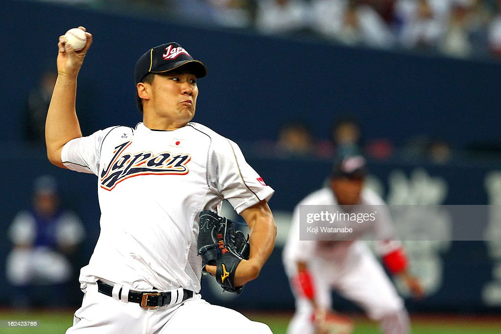 <a gi-track='captionPersonalityLinkClicked' href=/galleries/search?phrase=Masahiro+Tanaka&family=editorial&specificpeople=5492836 ng-click='$event.stopPropagation()'>Masahiro Tanaka</a> #17 of Japan Starting pitcher against Australia in the top half of the third inning during international friendly game between Japan and Australia at Kyocera Dome Osaka on February 23, 2013 in Osaka, Japan.