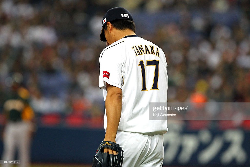 <a gi-track='captionPersonalityLinkClicked' href=/galleries/search?phrase=Masahiro+Tanaka&family=editorial&specificpeople=5492836 ng-click='$event.stopPropagation()'>Masahiro Tanaka</a> #17 of Japan Starting pitcher against Australia in the top half of the third inning in action during international friendly game between Japan and Australia at Kyocera Dome Osaka on February 23, 2013 in Osaka, Japan.