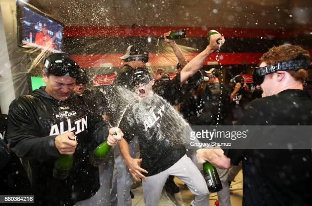 Masahiro Tanaka of the New York Yankees and teammates celebrate in the locker room after their 5 to 2 win over the Cleveland Indians in Game Five of...