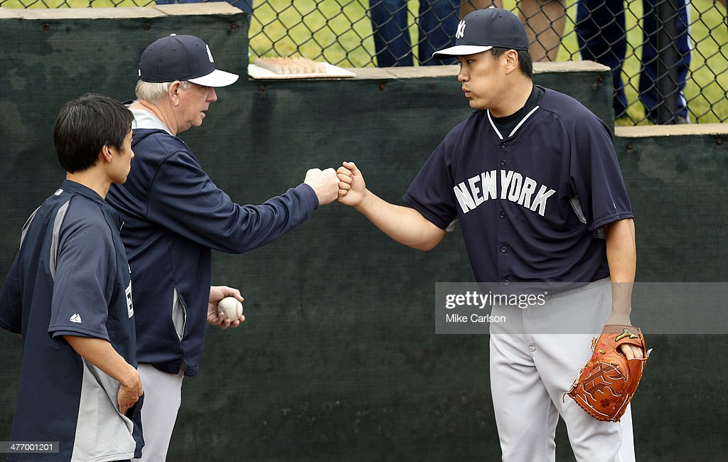<a gi-track='captionPersonalityLinkClicked' href=/galleries/search?phrase=Masahiro+Tanaka&family=editorial&specificpeople=5492836 ng-click='$event.stopPropagation()'>Masahiro Tanaka</a> #19 of the New York Yankees (R) bumps fists with pitching coach Larry Rothschild after warming up prior to a spring training game against the Philadelphia Phillies at Bright House Field on March 6, 2014 in Clearwater, Florida.