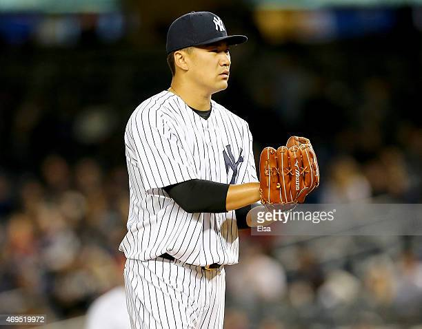 Masahiro Tanaka of the New York Yankees check the sign before a pitch in the first inning against the Boston Red Sox on April 12 2015 at Yankee...