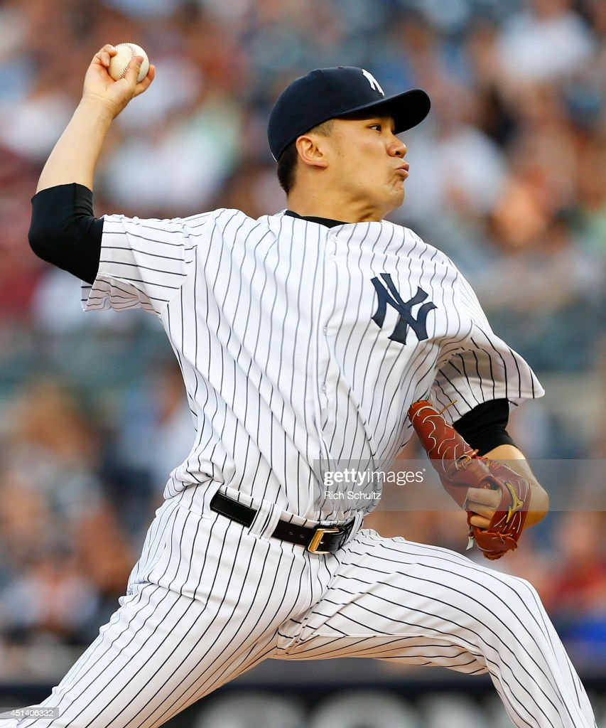 Masahiro Tanaka #19 of the New York Yankees delivers a pitch against the Boston Red Sox during the first inning in a MLB baseball game at Yankee Stadium on June 28, 2014 in the Bronx borough of New York City.