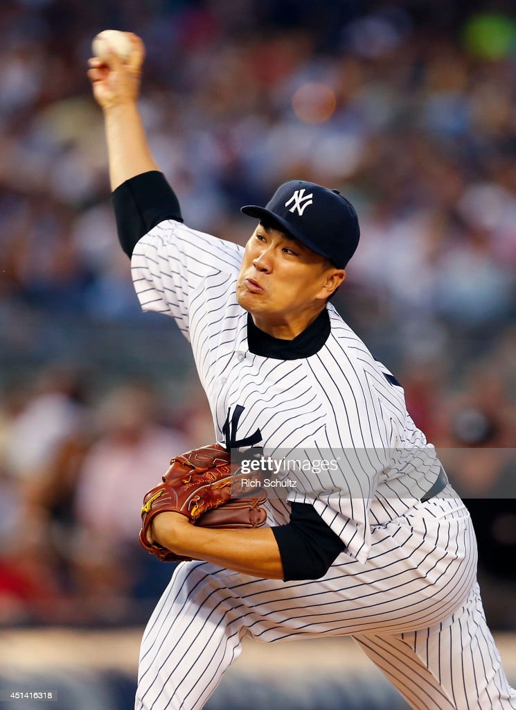 Masahiro Tanaka #19 of the New York Yankees delivers a pitch against the Boston Red Sox during the fifth inning in a MLB baseball game at Yankee Stadium on June 28, 2014 in the Bronx borough of New York City.