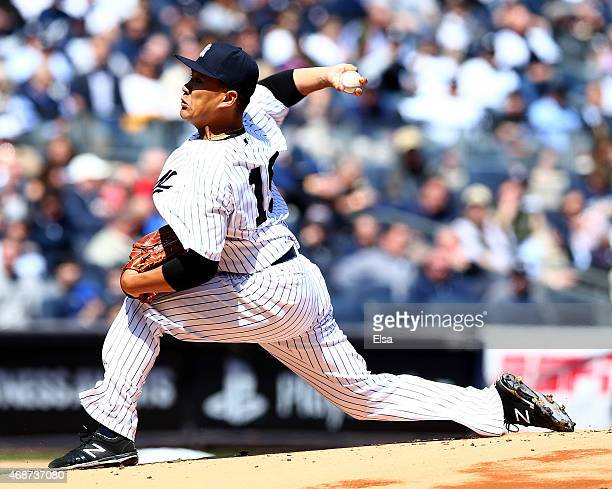 Masahiro Tanaka of the New York Yankees delivers a pitch in the first inning against the Toronto Blue Jays during Opening Day on April 6 2015 at...
