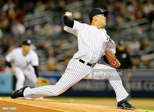 Masahiro Tanaka of the New York Yankees delivers a pitch in the first inning against the Boston Red Sox on April 12 2015 at Yankee Stadium in the...