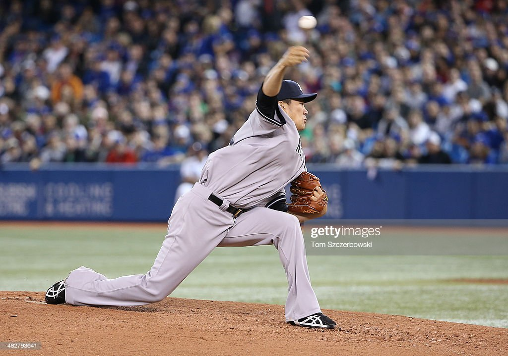 <a gi-track='captionPersonalityLinkClicked' href=/galleries/search?phrase=Masahiro+Tanaka&family=editorial&specificpeople=5492836 ng-click='$event.stopPropagation()'>Masahiro Tanaka</a> #19 of the New York Yankees delivers a pitch in the first inning during MLB game action against the Toronto Blue Jays on April 4, 2014 at Rogers Centre in Toronto, Ontario, Canada.